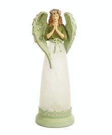 Pretty angel lamp creates a soft warm glow.