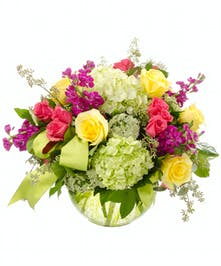 Stylish, colorful fresh flowers arranged in a bubble bowl.
