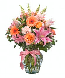 Shades of pink and orange combine to create this awesome bouquet.
