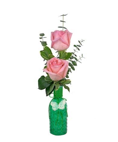 You choose gerber daisies, roses or spray roses in this sweet budvase.