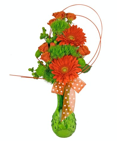 This green vase is filled with gorgeous flowers in bright green and orange.