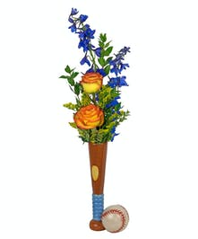 A baseball bat novelty vase with konfetti roses and blue delphinium.