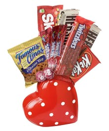polka dot heart on it's side arranged with candies and snack.