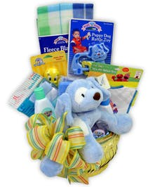 Baby items are arranged in a gift basket, perfect for the new little one.