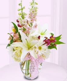 Make the new mom's day with a special delivery of flowers just for her!