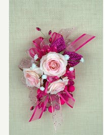 So pretty and delicate, petite pink corsage is very popular for local dances.