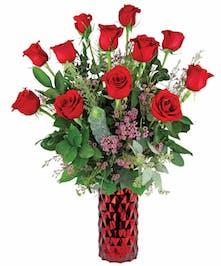 Gorgeous dozen red roses in deluxe red diamond vase.