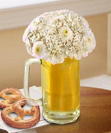 Toast your favorite people with with delightful beer mug of flowers!